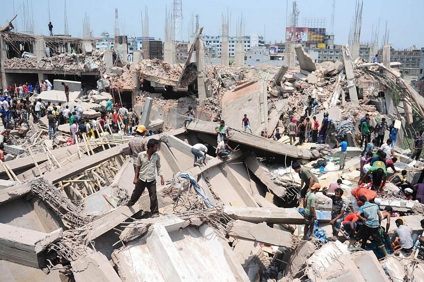 Bangladeshi civilian volunteers assist in rescue operations after an eight-storey building collapsed in Savar, on the outskirts of Dhaka on April 24, 2013.The Bangladesh government is refusing to shut down garment factories declared unsafe, fol