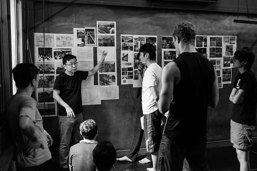 Drama Box director Kok Heng Leun (second from left) discussing the prison settlement of Pulau Senang with his cast for the production of Senang. Research notes are pinned on the studio wall. (Above): Director Claire Wong (second from right) takes act