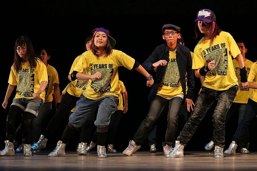 Redeafination (above), a hip-hop dance group for the hearing impaired, performing in Welcome To My World 2013, a concert organised by Very Special Arts. -- PHOTO: ROBIN NG