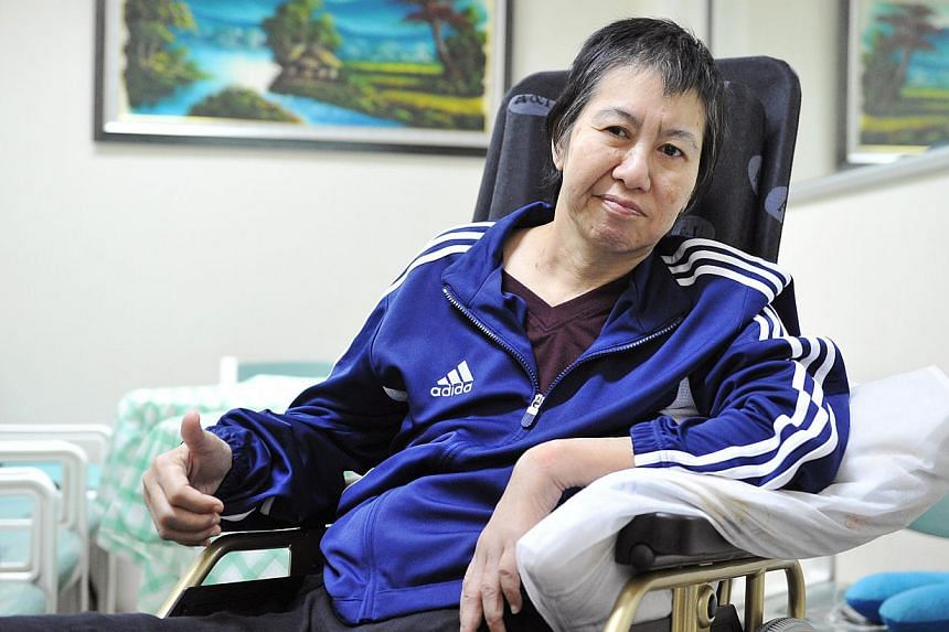 Humanitarian Organisation for Migration Economics founder Bridget Tan at the Ang Mo Kio - Thye Hua Kwan Hospital. She will be moving to Batam to continue her recuperation from a stroke.