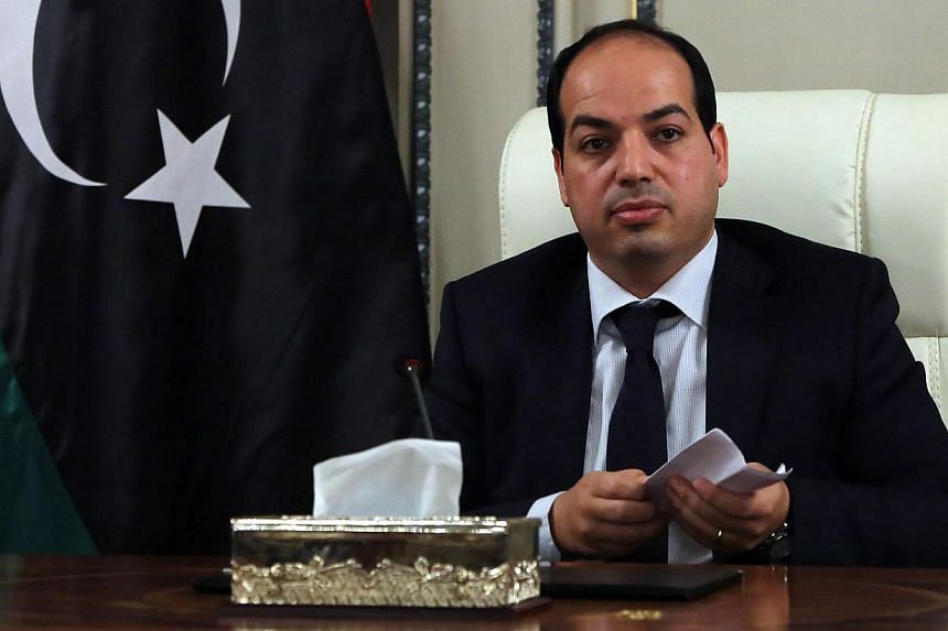 New Libyan Prime Minister Ahmed Miitig meets with his ministers for the first time on June 2, 2014 in Tripoli. -- PHOTO: AFP