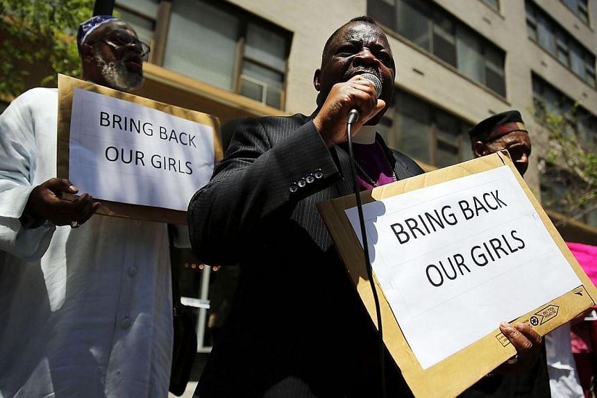 A man speaks as local clergy, activists and and community leaders protest for the safe return of the 276 abducted schoolgirls outside the Permanent Mission of Nigeria to the United Nations on June 2, 2014 in New York City. -- PHOTO: AFP