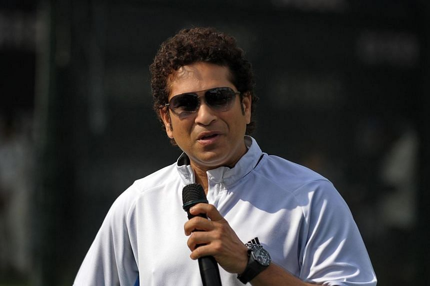Retired Indian cricketing legend Sachin Tendulkar holds a training session for young players at the Singapore Cricket Club on June 3, 2014. Tendulkar told reporters he welcomed the opportunity to play alongside West Indies great Brian Lara in the MCC