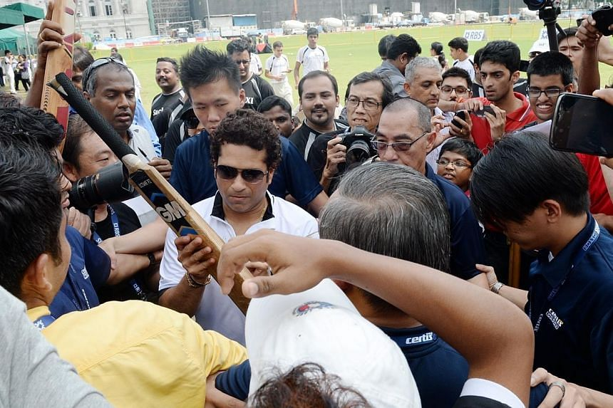 Legendary Indian cricketer Sachin Tendulkar shared his experiences and insights with a group of 30 young cricketers during a special coaching session at the Singapore Cricket Club on Tuesday morning.-- ST PHOTO: AZIZ HUSSIN