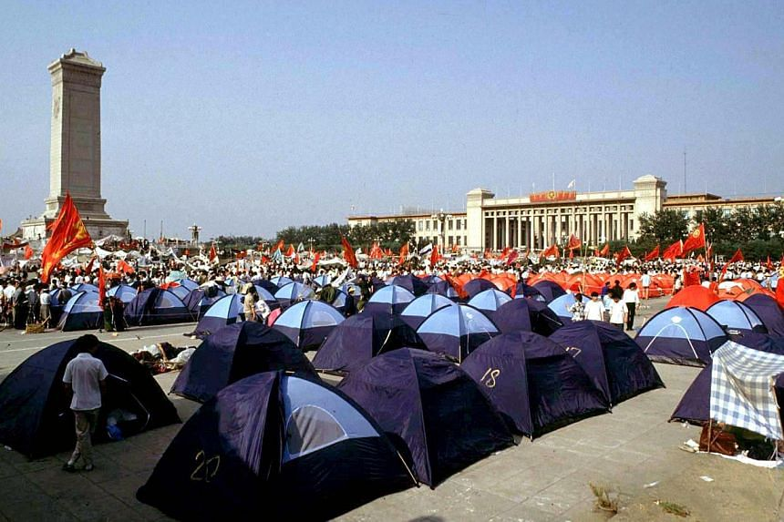 Pro-democracy demonstrators pitch tents in Beijing's Tiananmen Square before their protests were crushed by the People's Liberation Army in this June 3, 1989 file photo. June 4 marks the 25th anniversary of the suppression of pro-democracy protests i