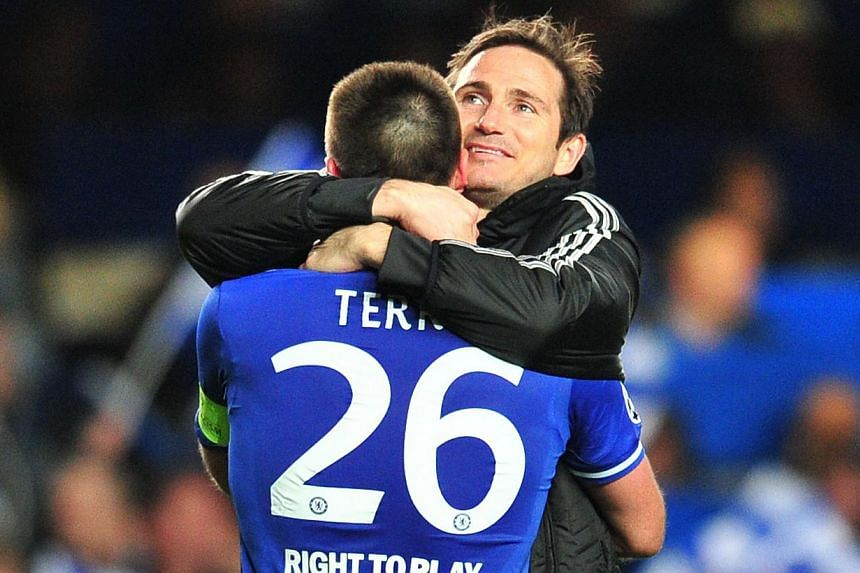 Chelsea's English defender John Terry (left) celebrates their victory with Chelsea's English midfielder Frank Lampard (right) after the final whistle during the Uefta Champions League quarter final second leg football match between Chelsea and Paris