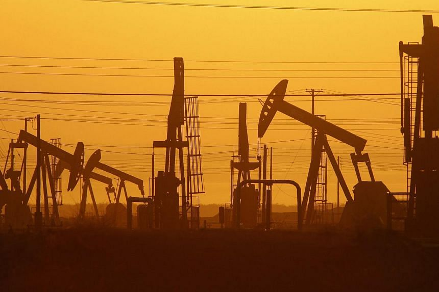 Pump jacks are seen at dawn in an oil field over the Monterey Shale formation on March 24, 2014 near Lost Hills, California. More than US$48 trillion (S$60.3 trillion) must be invested by 2035 to meet global energy needs as current technologies go of