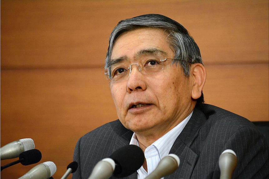 Kuroda reiterated that improvements in the economy have boosted domestic demand and narrowed Japan's output gap to near zero. -- PHOTO: AFP