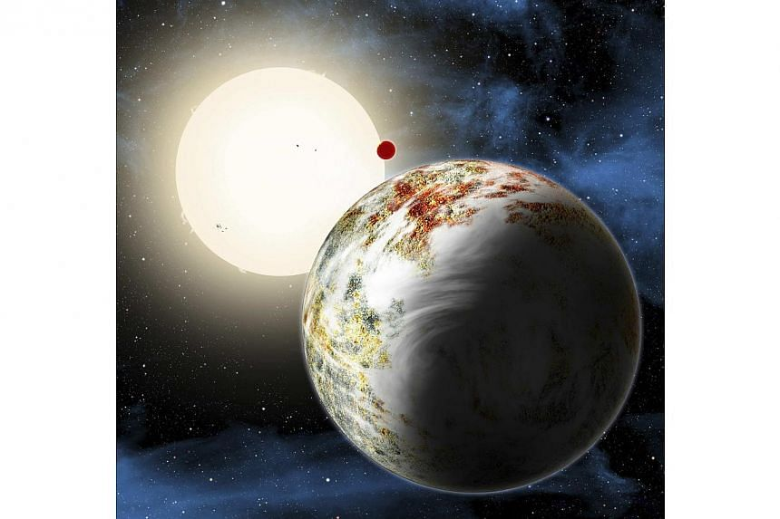 """The newly discovered """"mega-Earth"""" Kepler-10c dominates the foreground in this artist's conception released by the Harvard-Smithsonian Center for Astrophysics in Cambridge, Massachusetts on June 2, 2014. -- PHOTO: REUTERS"""