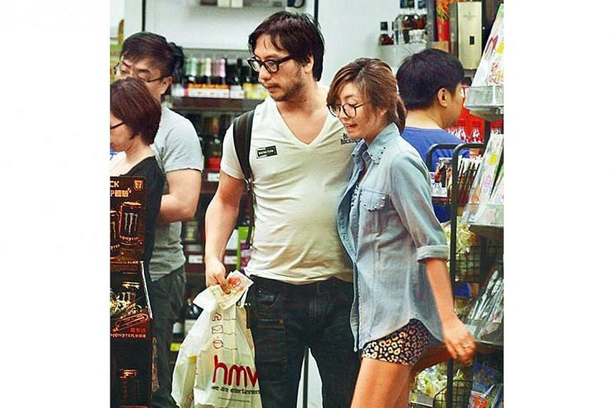 Liddy Li (right) made the headlines last week when Oxide Pang was photographed on a date with her. They were spotted at a convenience store after leaving Elements mall in Tsim Sha Tsui.-- PHOTO: APPLE DAILY