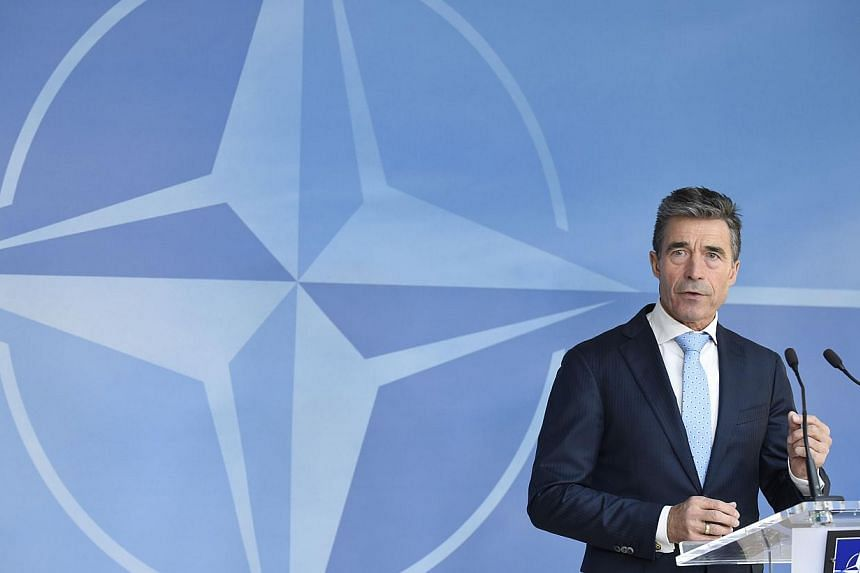 Secretary-General of the North Atlantic Treaty Organization (NATO) Anders Fogh Rasmussen gives a joint press conference before a Defence ministers meeting in Brussels on June 3, 2014. Nato head Anders Fogh Rasmussen dismissed presidential electi