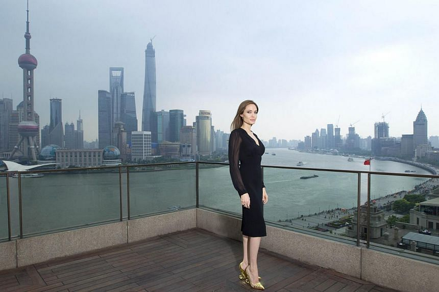 This handout photo released by the Walt Disney Company shows US actress Angelina Jolie posing on the terrace of a hotel in Shanghai during a press event on June 3, 2014.-- PHOTO: AFP