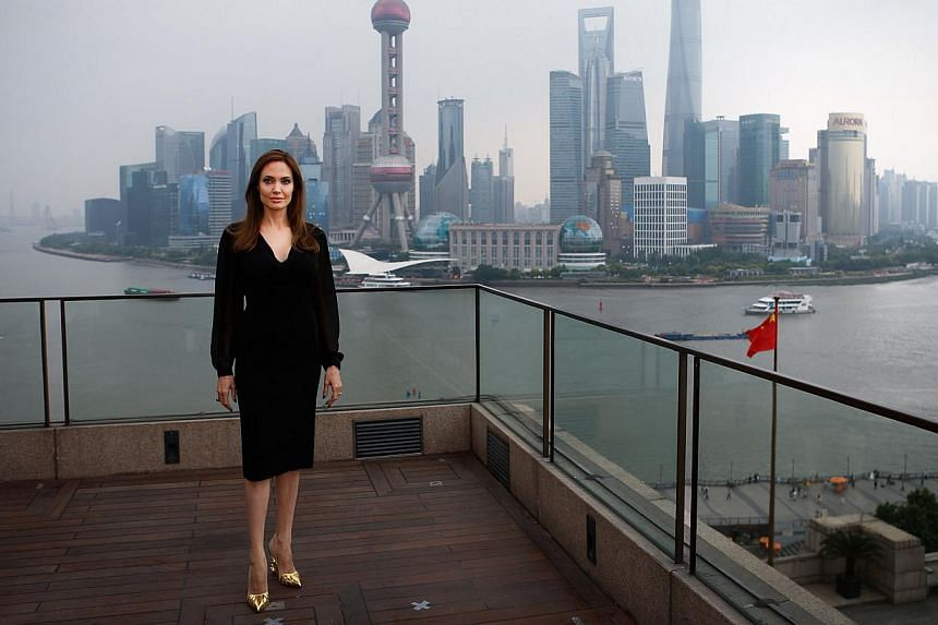 US actress Angelina Jolie poses on the terrace of a hotel in Shanghai during a press event on June 3, 2014.-- PHOTO: AFP