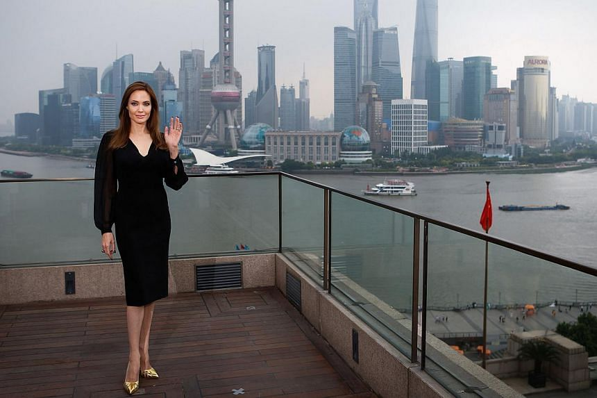 "Actress Angelina Jolie poses during a photocall as she takes part in a promotional tour for the film ""Maleficent"" in Shanghai June 3, 2014.  -- PHOTO: REUTERS"