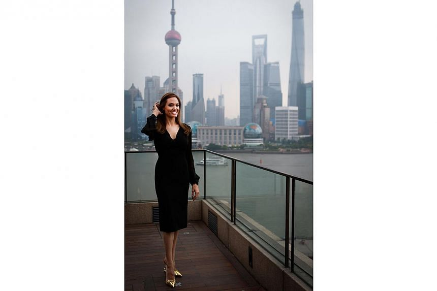US actress Angelina Jolie poses on the terrace of a hotel in Shanghai during a press event on June 3, 2014. -- PHOTO: AFP