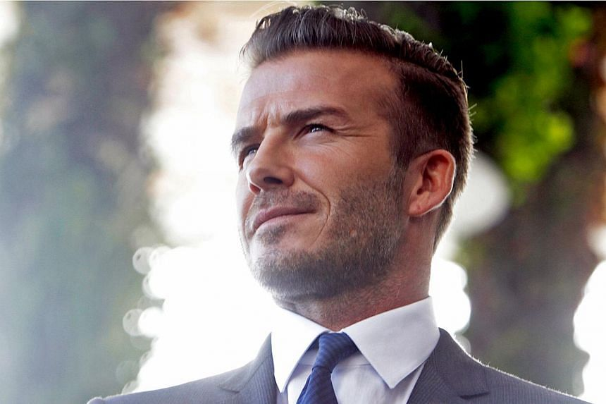 This photo taken on Feb 5, 2014, shows former football star David Beckham during a press conference at the Perez Art Museum in Miami, Florida.Beckham has hinted that he could come out of retirement and resume his football career. -- PHOTO: AFP