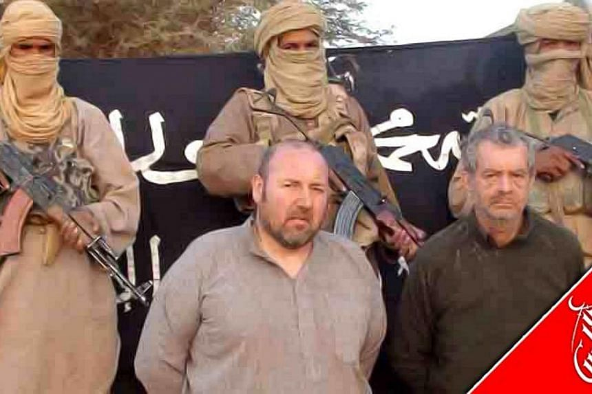 An undated handout image released by Al-Andalus, the media branch of Al-Qaeda in the Magreb (AQMI) to the Agence Nouakchott Informations (ANI) on December 9, 2011 shows French national Serge Lazarevic being held by AQMI at an undisclosed location.&nb