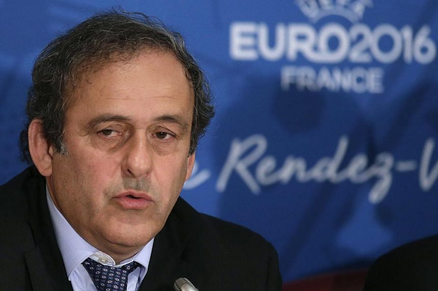 "Uefa president Michel Platini attends a news conference after a meeting held in preparation of the EURO 2016 soccer tournament in Paris on April 25, 2014. Platini on Tuesday attacked a British newspaper for seeking to ""tarnish"" his reputation by draw"