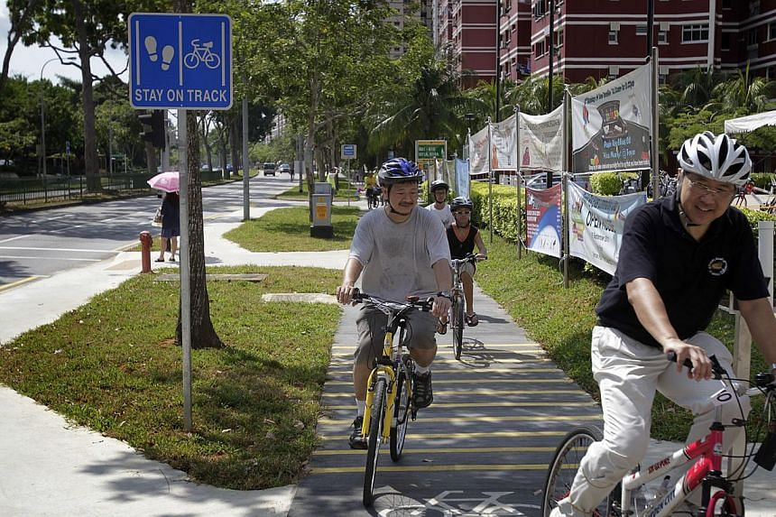 Cyclists trying out the new dedicated cycling path along Pasir Ris Drive 3. Giving priority to street-level crossings, providing protected bike lanes and setting lower speed limits for motorists are ways to promote walking and cycling in Singapore, s
