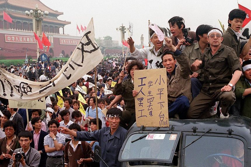 Chinese workers filling the streets of Beijing to support the students' pro-democracy movement and their hunger strike that started six days before during the Beijing Spring movement on May 18, 1989. -- PHOTO: AFP