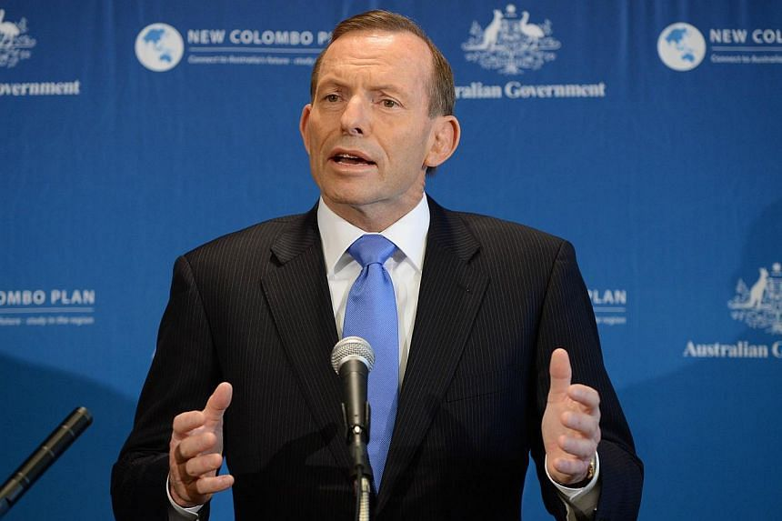 Australian Prime Minister Tony Abbott on Tuesday brushed off an apparent Indonesian protocol breach in which reporters listened to a phone call between the two nations' leaders intended to repair strained relations. -- PHOTO: AFP