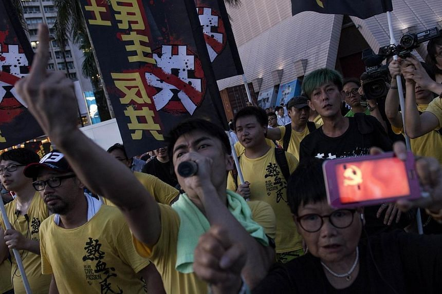 Pro-democracy activists scream at a pro-China group during a rally to mark the 1989 Tiananmen Square military crackdown, in Hong Kong on June 4, 2014. -- PHOTO: AFP