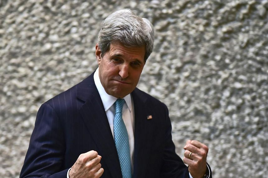 US Secretary of State John Kerry gestures after a conference in the framework of the Cleantech Challenge Mexico 2014, in Mexico City on May 21, 2014.US Secretary of State John Kerry arrived in Beirut on Wednesday, June 4, 2014, beginning an una