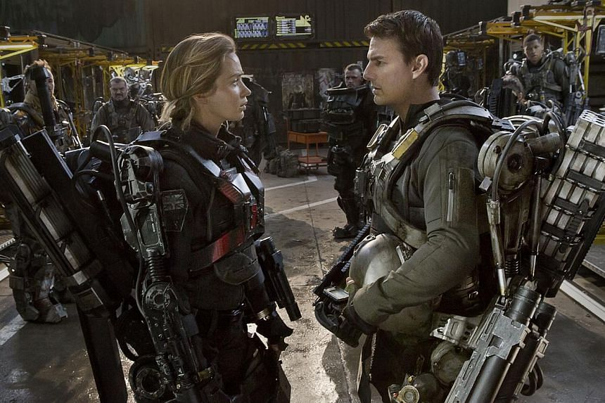 Emily Blunt and Tom Cruise (both above) don ExoSuits weighing more than 45kg each in Edge Of Tomorrow. -- PHOTO: GOLDEN VILLAGE