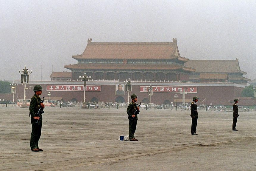 President Xi Jinping's plan is for China to achieve rich-country status by 2021 and to surpass the US by 2049. Tiananmen Square then and now: (Top) In June 1989, soldiers with automatic rifles stood on guard every 10m. (Above) A vast change has happe