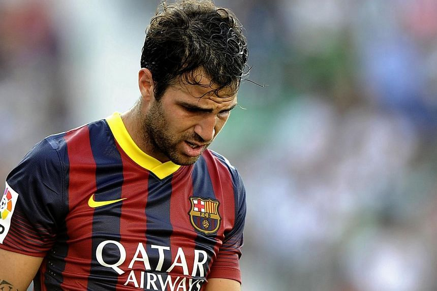 Arsenal midfielder Santi Cazorla would love to see Spanish compatriot Cesc Fabregas (above) re-join the London side with a return to the Premier League mooted for the Barcelona player. -- PHOTO: AFP
