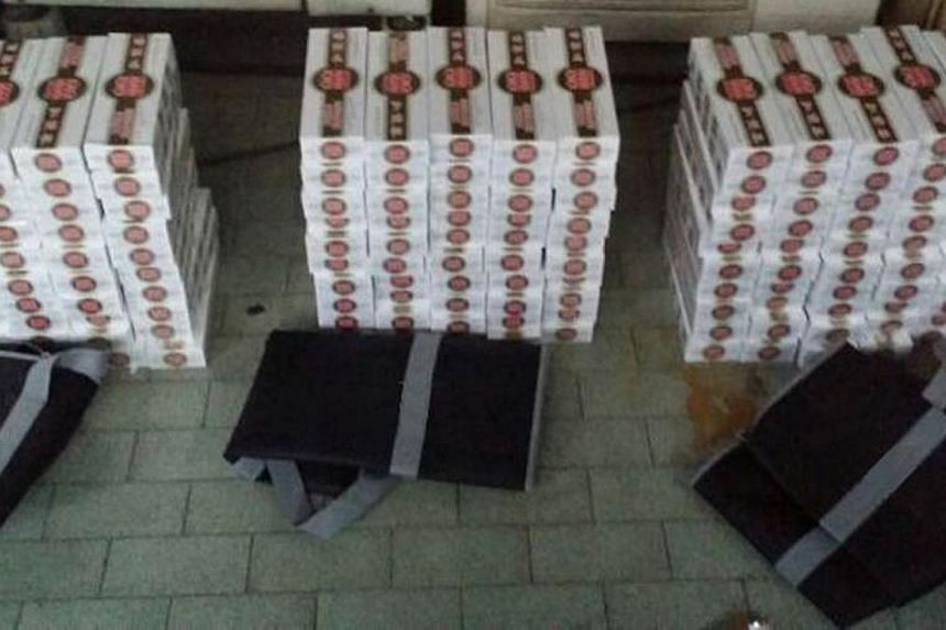 Contraband cigarettes worth over $42,300 were seized in an operation by Singapore Customs on May 31.Singapore Customs has busted a contraband cigarette distribution ring which operated out of an estate in Siglap. -- PHOTO: SINGAPORE CUSTOMS