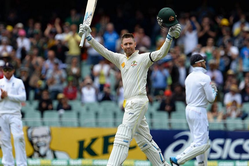 In this file photo dated Dec 6, 2013, Australian batsman Michael Clarke (centre) celebrating after scoring a century against England on the second day of the second Ashes cricket Test match in Adelaide.Australian cricket captain Michael Clarke