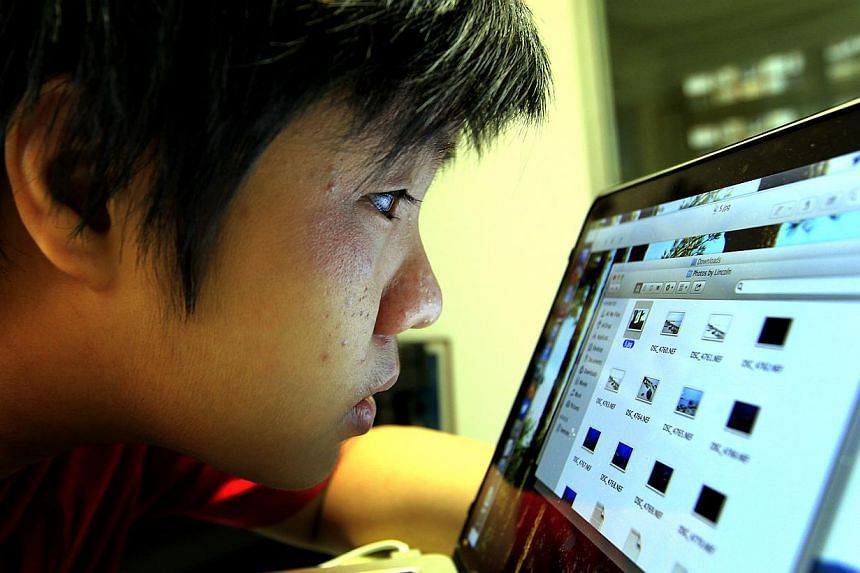 St Hilda's Secondary School student Joshua Tseng has to peer closely at a computer screen to make out what is on it. Looking through his right eye is like looking through a frosted pane, and his left eye can only make out shapes, colours and light.