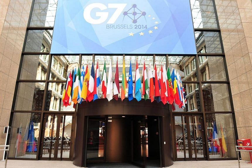 A view of a sign announcing the upcoming G7 summit, in front of the atrium of the European Union Council Building, which was transformed into a press center for the occasion, at the EU Headquarters in Brussels, on June 2, 2014. -- PHOTO: AFP