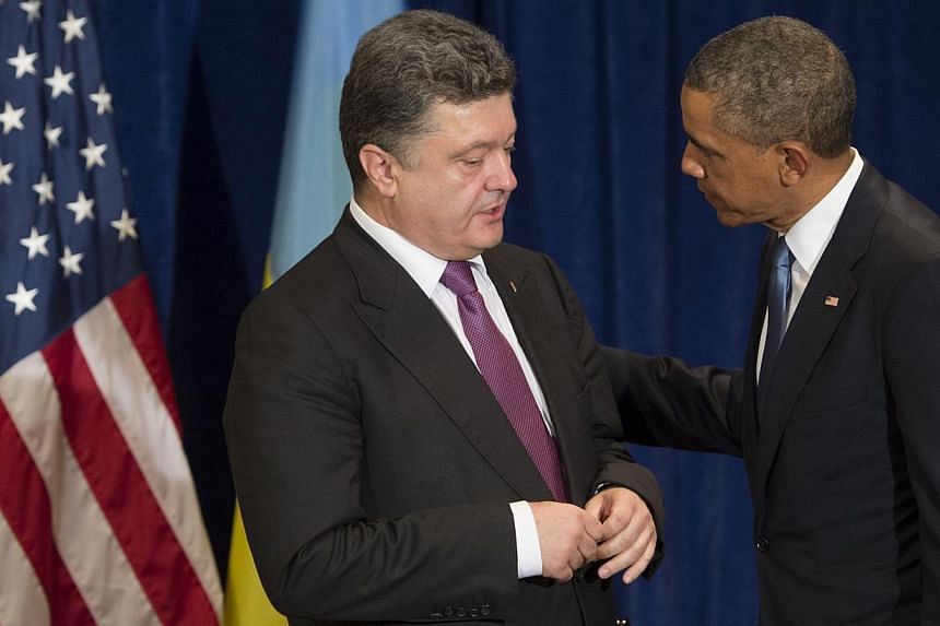 US President Barack Obama and President-elect Petro Poroshenko of Ukraine talk during a meeting in Warsaw, Poland, on June 4, 2014.Mr Obama met Mr Poroshenko on Wednesday, in a show of US support for Ukraine's right to chart its own future, bef