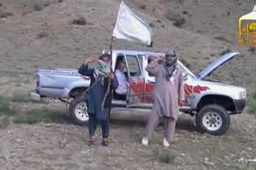 U.S. Army Sergeant Bowe Bergdahl (centre) waits in a pick-up truck before he is freed at the Afghan border, in this still image from video released on June 4, 2014.-- PHOTO: REUTERS