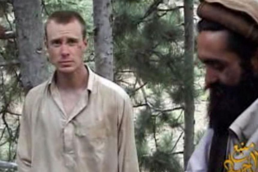 This still image provided on Dec 7, 2010 by IntelCenter shows the Taliban associated video production group Manba al-Jihad Dec 7, 2010 release of US Sergeant Bowe Bergdahl (left), who has been held hostage by the Taliban since his disappearance from
