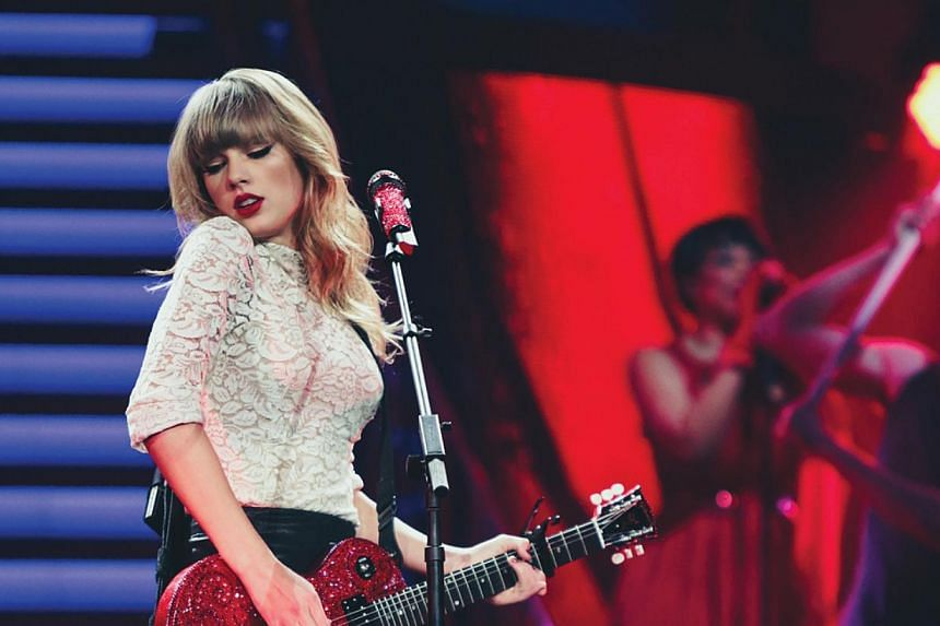 Taylor Swift performs during her RED Tour in Shanghai, on May 30, 2014. -- PHOTO: AEG LIVE