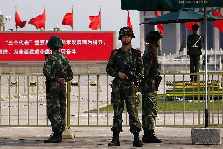 Paramilitary policemen stand guard at the Monument to the People's Heroes at Tiananmen Square near the Great Hall of the People, ahead of the 25th anniversary of the crackdown on pro-democracy protests, in Beijing on June 3, 2014. -- PHOTO: REUTERS