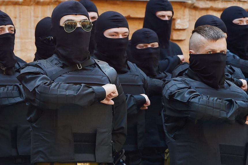 Fighters of Social Nationalist Assembly (SNA), part of ultra-nationalist Right Sector party, swear in Kiev prior their leaving on June 3, 2014.Government forces pressed on with an offensive against pro-Russia separatists in eastern Ukraine on W