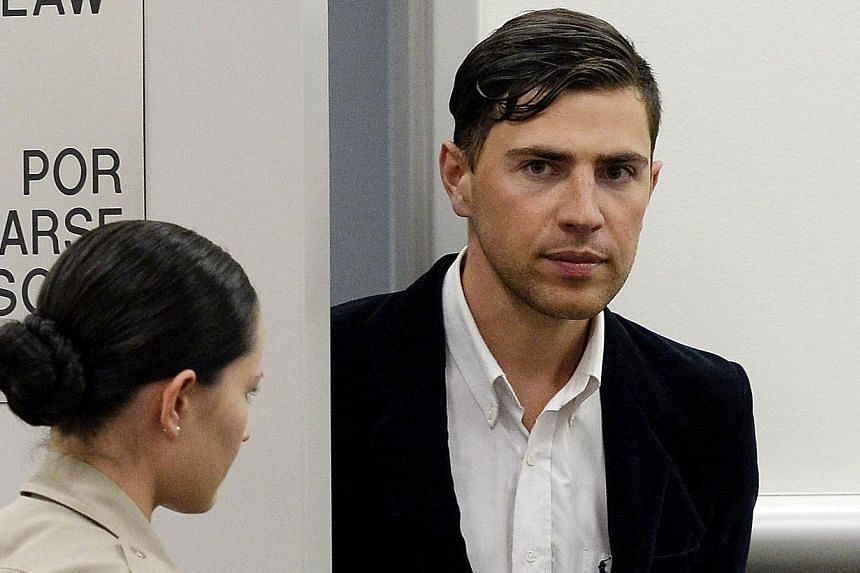 Vitalii Sediuk, a 25-year-old Ukrainian TV reporter, is escorted by Los Angeles County Sheriff deputy as he appears in an East Los Angeles Courthouse for arraignment in Los Angeles, California on May 30, 2014. -- PHOTO: REUTERS