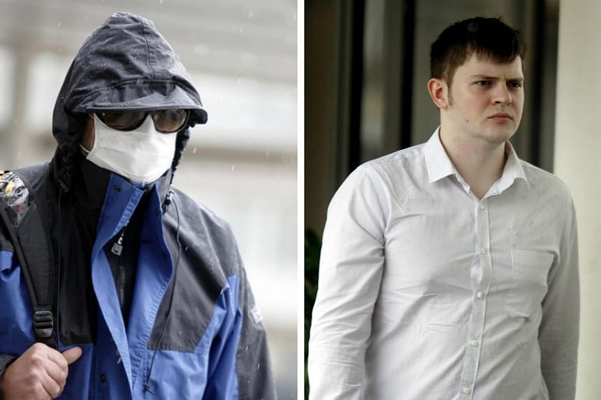 Singaporeans Vasily Chuply (right) and Alexander Kalinin were on Thursday, June 5, 2014, each fined $1,000 over a 20-second scuffle outside the State Courts in Havelock Square. -- ST PHOTOS: WONG KWAI CHOW