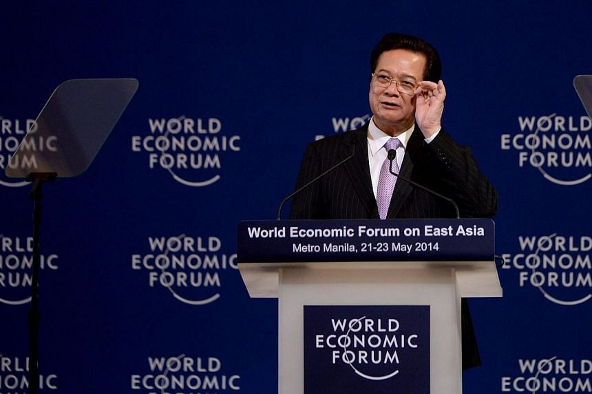 Prime Minister of Vietnam, Nguyen Tan Dung, gestures as he gives his remarks during the World Economic Forum on East Asia in Manila on May 22, 2014.Vietnam's prime minister pledged on Thursday, June 4, 2014, to step up economic reforms and prev