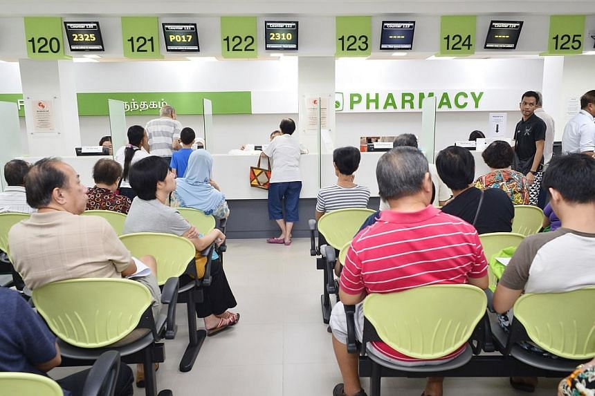 Patients waiting for their medicine at the pharmacy of Tampines Polyclinic. -- PHOTO: ST FILE