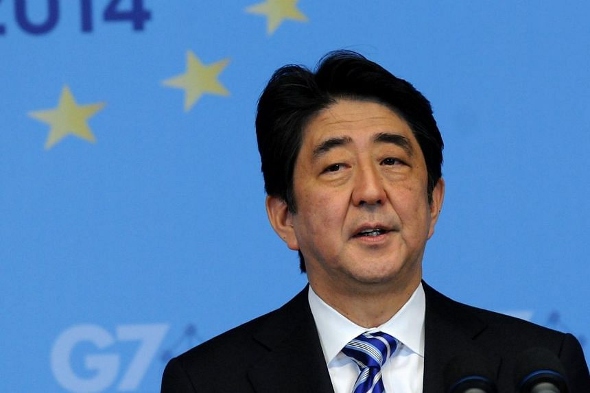 Japan's Prime Minister Shinzo Abe holds a press conference on the last day of the G7 summit at the European Council headquarters on June 5, 2014 in Brussels.Mr Abe, hours after joining fellow industrial powers in threatening further sanctions a