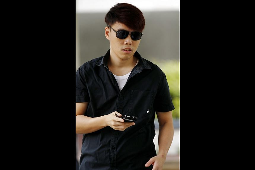 Calvin Kam Mao Xiong, 27, a former SingTel employee who received kickbacks from friends for waiving portions of their phone bills, was fined $6,000 for corruption on Thursday, June 5, 2014. -- ST PHOTO: WONG KWAI CHOW