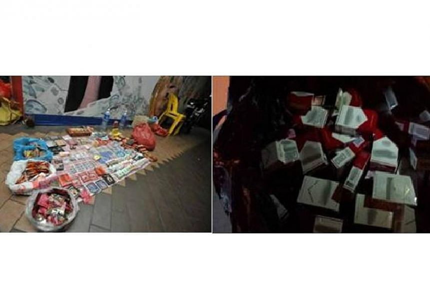A total of 121 people were arrested in Geylang on Tuesday, June 3, 2014, and Wednesday, June 4, 2014, for various offences in a multi-agency operation. -- PHOTO: SINGAPORE POLICE FORCE