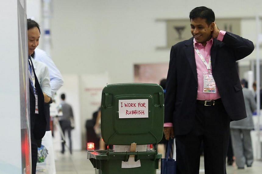 """Cre8 Technology's remote-controlled miniature trash bin is among the new generation of """"clean technology"""" on display."""