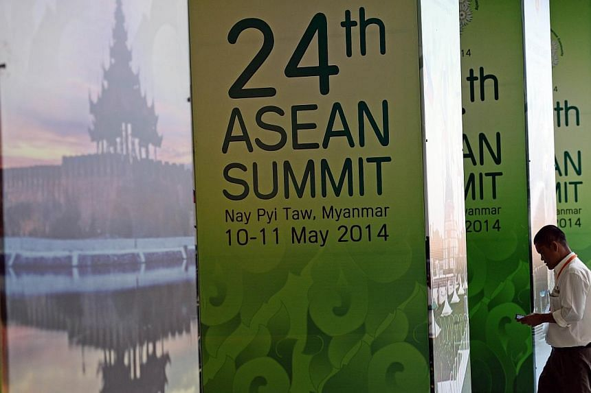 A man walking past poster-covered pillars outside the Asean Summit venue in the Myanmar International Convention Centre last month. In 1979 when Vietnam overran then-Kampuchea, Asean was split.