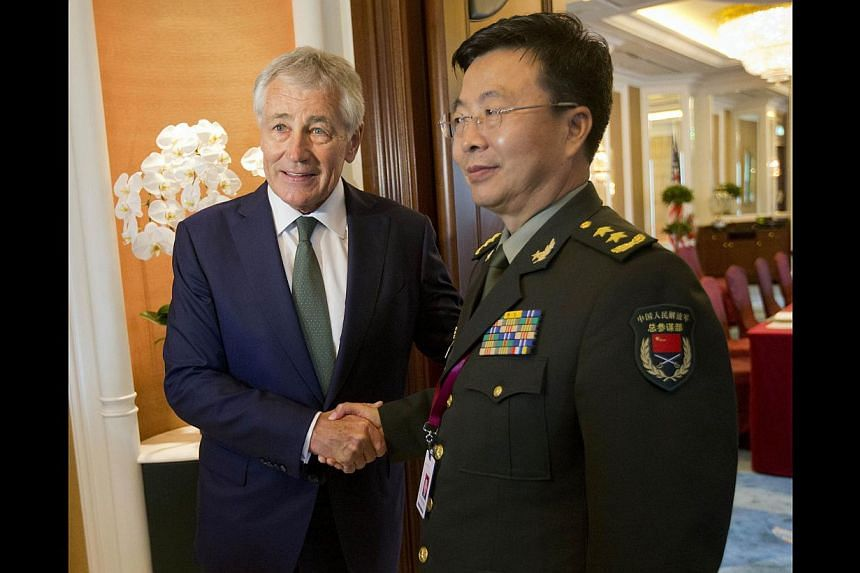 US Defence Secretary Chuck Hagel (left) meeting China's Lt-Gen Wang Guanzhong, the deputy chief of general staff of the People's Liberation Army, in Singapore last Saturday.